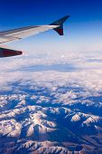 View of the Southern Highlands of the South Island of New Zealand covered in snow early in the morning from the air
