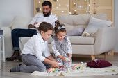Dad And Children Have Fun Together, Dad Watches Son And Daughter Play On The Couch poster