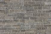 Texture Of The Brickwork In The Wall. Relief And Background Of The Defensive And Enclosing Wall. The poster