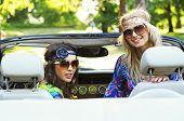 Smiling women in a cabrio