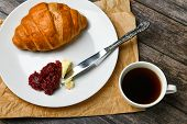 Breakfast With Croissant. The Beginning Of The Morning. Fresh French Croissant. Coffee Cup And Fresh poster