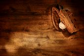 Old Baseball Glove And Ball On Wood Background