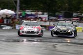 KUALA LUMPUR - MAY 20: Daigo Saito (black Lexus) chases Max Orido (red/white RSR) during the Formula