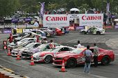 KUALA LUMPUR - MAY 20:The final 16 qualifiers park their competition cars in a parade in front of th