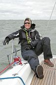 Relaxing during sailing on the IJsselmeer in the Netherlands