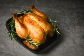 Whole Roasted Chicken Rosemary / Baked Chicken Grilled Barbecue Delicious Food On Dining Table At Ho poster