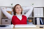 Relaxed female student at her desk leaning back