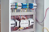Reversible Assembly Of Two Power Contactors, Phase Control Relays, Circuit Breakers In The Electrica poster