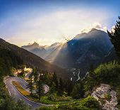 Aerial View Of Maloja Pass Road In Switzerland At Sunset. This Swiss Alps Mountain Road Is Located I poster