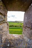 View Through Carisbrooke Castle Window To England Rural Landscape, Isle Of Wight, England poster