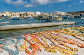 Traditional Colorful Maltese Fishing Nets On Concrete Pier. Fishing Nets Left For Dry In Marshallock poster