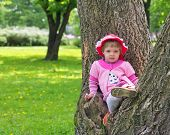 Little Girl Climbed On Tree And Sitting On It