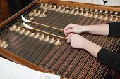 Czech Dulcimer with player hands with hammers