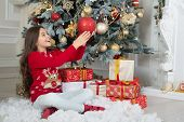 Believe In Magic Of Christmas. Child Under Xmas Tree. Little Child Decorate Christmas Tree. Happy Ch poster