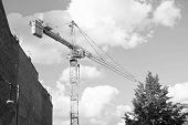 Construction Crane On Construction Site Cloudy Sky Background. Architecture And Building. Technology poster