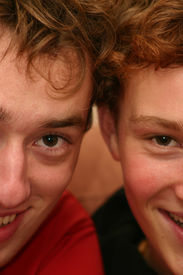 pic of teenage boys  - Two brothers smiling with half their faces - JPG