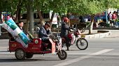 Lhasa, Tibet China - July 3: Local Tibetans Are Driving Vehicles Stopped At A Traffic Junctions July
