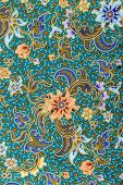 stock photo of batik  - Close up flower pattern background on batik fabric - JPG