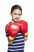 Young Girl Wearing Boxing Gloves Angry