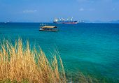 image of pontoon boat  - Industrial Boat On The Sea With Blue Sky - JPG