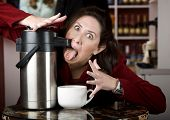 Woman Drinking Coffee Directly From A Dispenser