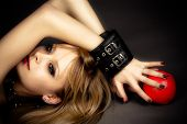 stock photo of handcuffs  - beautiful blond sexy girl in leather handcuffs - JPG
