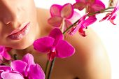 Pretty Beautiful Relaxing Woman With Purple Orchids