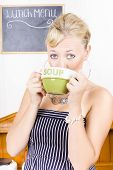 Pretty Retro Woman Drinking Hot Cup Of Soup