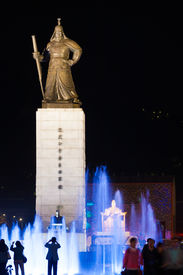 stock photo of hangul  - Tourists gather at the fountain at King Sae Jong Dae statue at night a major landmark in the heart of downtown Seoul South Korea - JPG