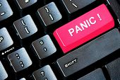 Red PANIC button on a computer keyboard