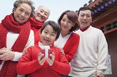 Multi-generation family in traditional Chinese courtyard