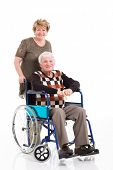 disabled old man sitting on wheelchair with caring wife on white background