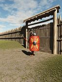 stock photo of guardsmen  - Imperial Roman legionary guarding the gate to a fort - JPG
