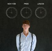 Businessman With New York Paris And London Chalk Time Zone Clocks On Blackboard Background
