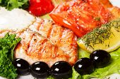 Tasty And Appetizing Fish Grill With Olives
