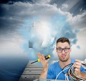 Composite image of portrait of confused young it professional with screw driver and cables in front of open cpu