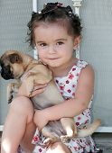 Baby In Curlers Holding A Puppy Sitting