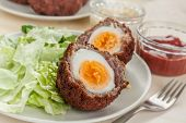 Scotch eggs- free range organic boiled eggs in a layer of sausage meat wrapped in streaky bacon coated in crispy bread crumbs and fried in vegetable oil