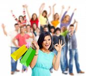 Woman with shopping bags over people group background