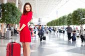 Beautiful woman in airport. Business travel background.