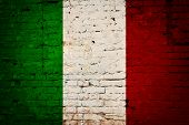 picture of italian flag  - Italian flag printed on grunge wall of brick - JPG