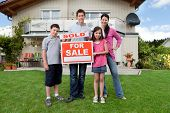 Young Family Happy To Have Bought A Home