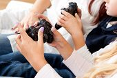 Kids Playing Console Games Using Joystick
