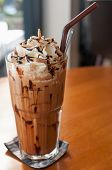 stock photo of frappe  - Iced coffee with whipped cream and sprinkle with almonds - JPG