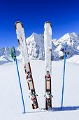 Ski, winter season , mountains and ski equipments on ski run