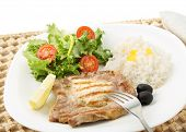 beef chops with rice and salad isolated on white (top)