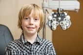 Portrait of preadolescent boy smiling at optician