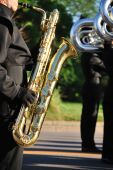 Marching Band Performer Playing Baritone Saxophone In Parade