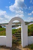 Menorca Cala Sa Mesquida Mao Maon arch entrance in Balearic islands