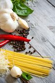 Garlic, Pepper, Basil, Pasta And Parmigiano Background